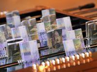 Francul elvetian s-a apreciat in fata euro. Cursul a scazut pentru prima data sub limita impusa de banca Elvetiei