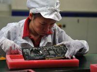 Secrete uluitoare din interiorul fabricilor Apple din China: plase anti-sinucidere la ferestrele dormitoarelor si 60 de ore de munca pe saptamana