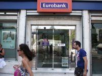 Grupurile bancare elene NBG si EFG Eurobank, prezente si in Romania, negociaza fuziunea, pentru a face fata crizei