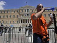 Grecia sa pregateste sa concedieze 150.000 de bugetari, un sfert din numarul total