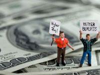 Salariul mediu al bancherilor de top din SUA si Europa a scazut cu 10% anul trecut