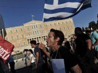 Troica cere bancilor din Grecia sa dea afara 30% din personal, aproape 18.000 de angajati
