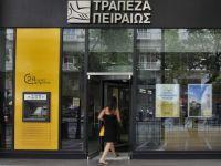 "Piraeus Bank sterge datorii de pana la 20.000 de euro pentru clientii afectati de ""criza umanitara"" din Grecia"