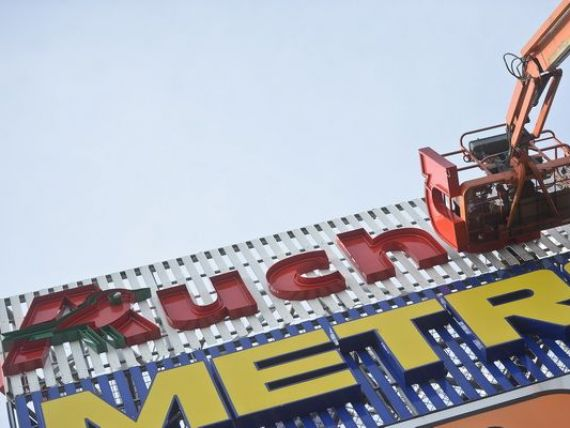 Tranzactia Auchan - Real, la limita conditiei de renuntare la magazinele din anumite orase