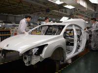 Profitul Peugeot pe 2013, impact negativ de 1,1 mld. euro