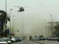 Cel putin doi jurnalisti au murit in atentate sinucigase comise la sediul unui post tv din Irak