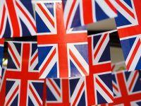 Ministrul de Interne de la Londra:  Muncitorii romani si bulgari ar putea face mai mult pentru M.Britanie decat britanicii