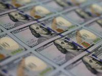 Dolarul s-a depreciat la minimul ultimelor cinci luni fata de un cos de valute importante