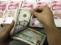 Inca un pas catre liberalizarea cursului. China a dublat banda in care yuanul poate varia liber in raport cu dolarul