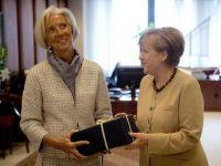 Reuters: Angela Merkel, cea mai puternica femeie din lume, o vrea pe Christine Lagarde sefa peste Europa. Directorul FMI, in carti pentru preluarea presedintiei CE