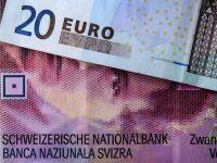 Euro a crescut cu 1,3 bani, la 4,4274 lei; francul elvetian cu 3,3 bani, la 4,2140 lei; dolarul si mai puternic, cu 5 bani, la 3,9089 lei