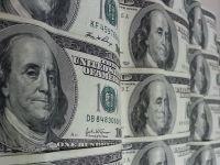 De ce un dolar puternic nu e bun pentru economia Americii. Cati bani au pierdut companiile din SUA si Canada din cauza aprecierii monedei americane