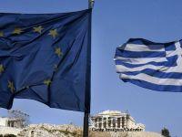 Grecia mai primeste 11 mld. euro de la creditorii internationali, bani cu care Atena isi va plati facturile restante