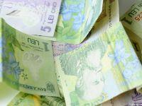 Leul castiga teren in fata principalelor valute. 1 euro= 4,4744 lei, 1 dolar = 3,9623 lei
