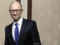 Presedintele Ucrainei cere demisia premierului Iateniuk