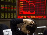 Unde de șoc pe piețele financiare. Bursele din Asia și Europa scad ca urmare a prăbușirii bursei de la New York. Teodorovici: Scăderea burselor nu ne afectează. Investitorii au încredere în România