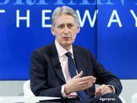 Ministrul britanic de Finante spune ca Londra va insista pentru un acord comercial cu UE, dupa Brexit, la doua zile dupa ce Theresa May anuntase ruperea totala de UE