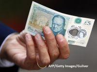 Marea Britanie ajunge la un număr record de angajați, însă creșterea salariilor încetinește neașteptat