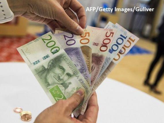 Țara care s-a grăbit să renunțe la bani întâmpină primele probleme. Avertismentul specialiștilor:  Suntem naivi să credem că putem abandona complet numerarul