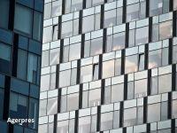 """""""Cartierul financiar"""" al Bucureștiului se sufocă. Clădirile din sticlă în care se fac milioane de euro contrastează cu lipsa infrastructurii şi cu mizeria"""