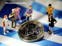 Filmul unui faliment evitat. Europenii care nu puteau să retragă de la bancomat mai mult de 60 de euro pe zi au liber să-și scoată banii din țară